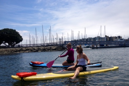 Sitting on paddle boards