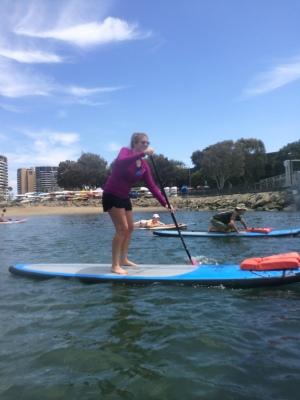 Kayla paddle boarding